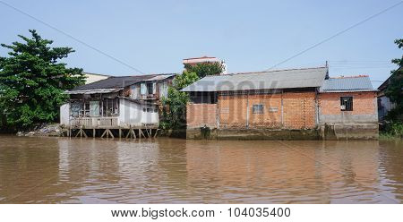 Houses Of Local People Staying Along River