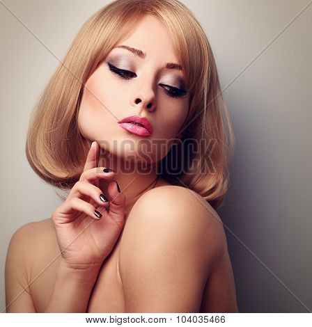 Beautiful Makeup Woman With Perfect Clean Skin Looking Down And Touching Fingers The Face