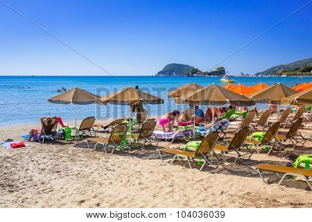 LAGANAS, GREECE - AUG 21, 2015: People on the beach of Laganas on Zakynthos island, Greece. Laganas is a very popular holidays destination full of nightclubs, bars and restaurants.