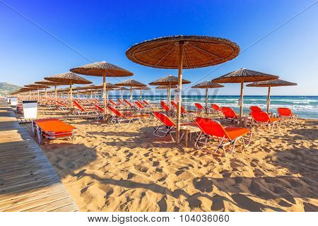 LAGANAS, GREECE - AUG 23, 2015: Umbrellas and sundecks of the sandy Banana Beach on Zakynthos, Greece. Banana is the largest beach of Zakynthos island.