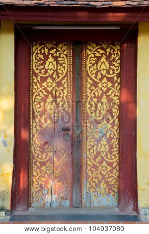 Beautiful ancient door in the temple. Laos.