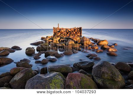 Sunrise summer landscape with old broken pier