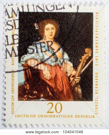 Gdr - Circa 1976: A Stamp Printed In Gdr Shows A Viol Player By Bernardo Strozzi, Circa 1976