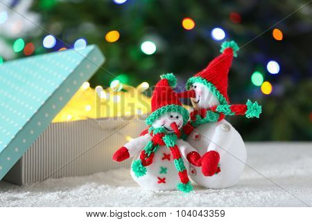 Cute snowmen on Christmas background
