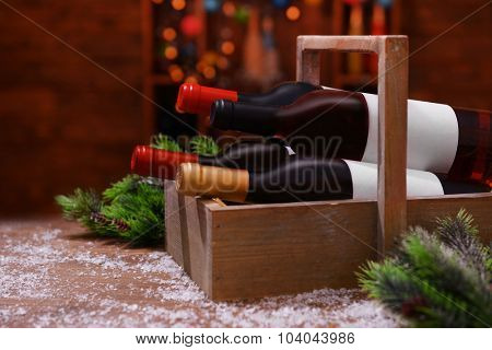 Beautifully decorated box with bottles of wine on unfocused background