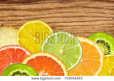 Citrus Fruits Of Lemon, Orange, Grapefruit, Lime On Wooden Texture