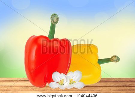 Fresh Yellow And Red Paprika Pepper On Wooden Table Over Nature Background