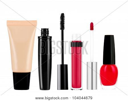 Foundation, Mascara, Lip Gloss And Nail Polish Isolated On White Background