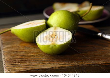 Ripe tasty pears on table close up