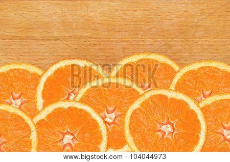 Fresh Orange Slices On Wooden Cutting Board