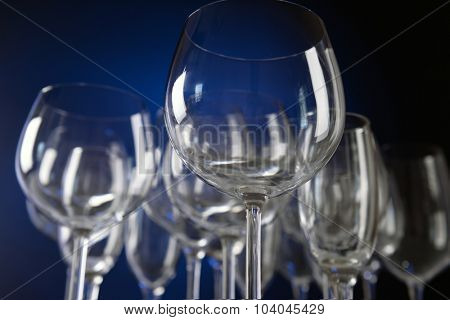 Empty wine glasses on blue background