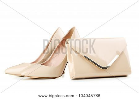 Pair Of Beige Women's High-heeled Shoes With Handbag Isolated On A White