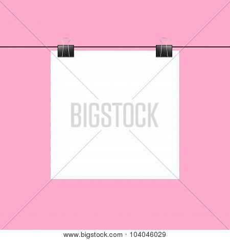 Blank Square Paper Hanging On Two Paper Clips