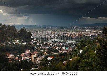 The city of Antananarivo with heavy rain shower on the horizon. Madagascar