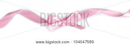Pink ribbon bow isolated on white