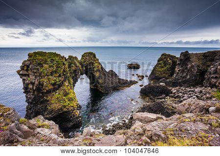Picturesque coastal cliffs Arnastapi. Travel to Iceland in the summer