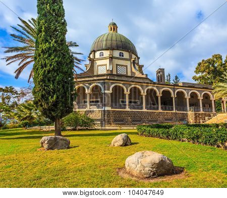 Basilica of the monastery of Mount Beatitudes. The magnificent dome surrounded by a colonnade. Israel, lake Tiberias