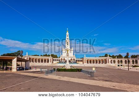 The magnificent cathedral complex with colonnade and large area in front of them. Portugal. City Fatima - Catholic pilgrimage center