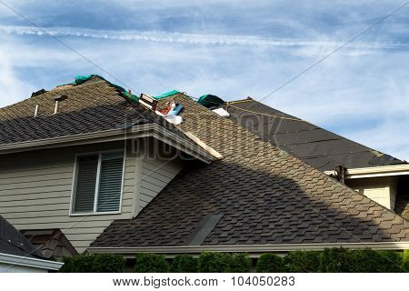 Home Roof Being Replaced With New Composite Roofing Materials