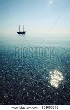 Calm Sea With A Sailing Vessel. Morning. Sailing Ship Profile.