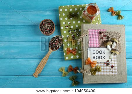 decorated cookbook on blue wooden background