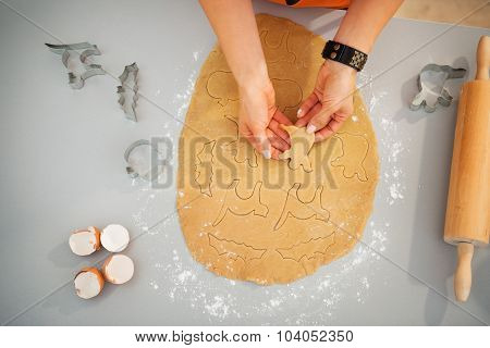 Woman Making Cookies For Halloween Party. Closeup