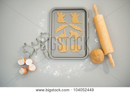 Uncooked Halloween Biscuits On Tray On Table. Closeup