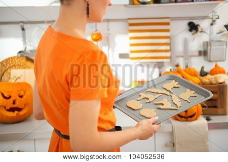 Closeup On Woman With Tray Of Uncooked Halloween Biscuits