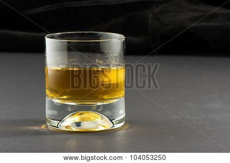 Whisky and ice with black background