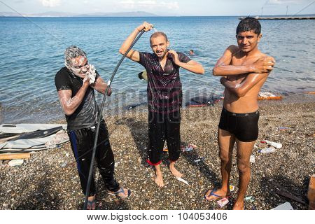 KOS, GREECE - SEP 27, 2015: Unidentified war refugees wash up on the beach. Kos island is located just 4 kilometers from the Turkish coast, and many refugees come from Turkey in an inflatable boats.