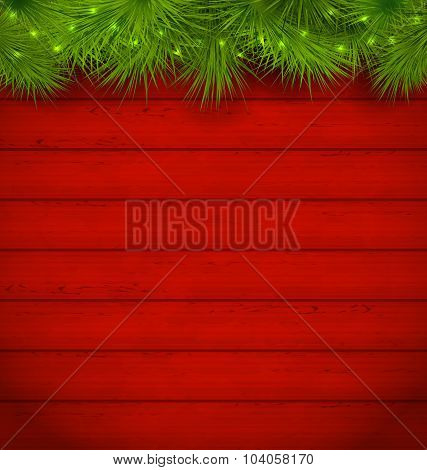 Christmas wooden background with fir twigs
