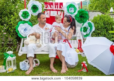 happy family on a bench in a garden