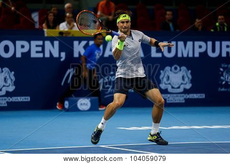 KUALA LUMPUR, MALAYSIA - OCTOBER 01, 2015: David Ferrer of Spain hits a forehand return in his match at the Malaysian Open 2015 Tennis tournament held at the Putra Stadium, Malaysia.