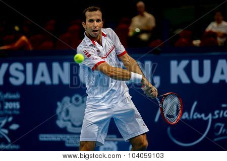 KUALA LUMPUR, MALAYSIA - OCTOBER 01, 2015: Radek Stepanek of the Czech Republic plays a backhand return in his match at the Malaysian Open 2015 Tennis tournament held at the Putra Stadium, Malaysia.