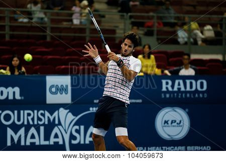 KUALA LUMPUR, MALAYSIA - OCTOBER 01, 2015: Feliciano Lopez of Spain plays a forehand return during his match at the Malaysian Open 2015 Tennis tournament held at the Putra Stadium, Malaysia.