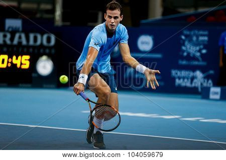 KUALA LUMPUR, MALAYSIA - OCTOBER 01, 2015: Vasek Pospisil of Canada plays a backhand return during his match at the Malaysian Open 2015 Tennis tournament held at the Putra Stadium, Malaysia.