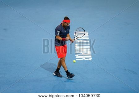 KUALA LUMPUR, MALAYSIA - OCTOBER 01, 2015: Marcos Baghdatis of Cyprus reacts after playing a winner in his match at the Malaysian Open 2015 Tennis tournament held at the Putra Stadium, Malaysia.