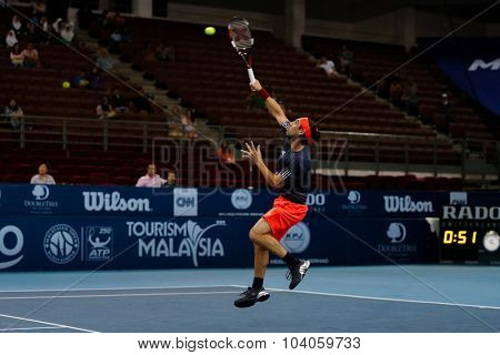 KUALA LUMPUR, MALAYSIA - OCTOBER 01, 2015: Marcos Baghdatis of Cyprus plays a smash return during his match at the Malaysian Open 2015 Tennis tournament held at the Putra Stadium, Malaysia.
