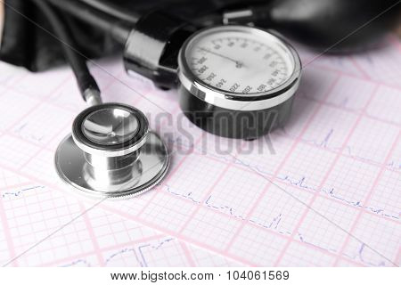 Blood pressure meter, digital tablet and stethoscope, on wooden background