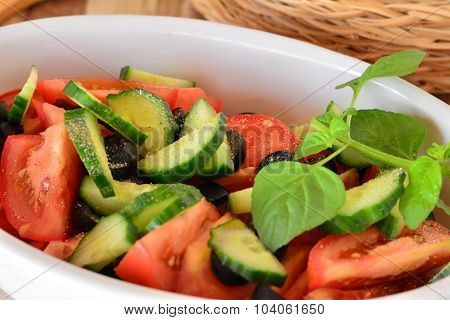 Healthy vegetable salad with cucumber,tomatoes on a porcelain bowl