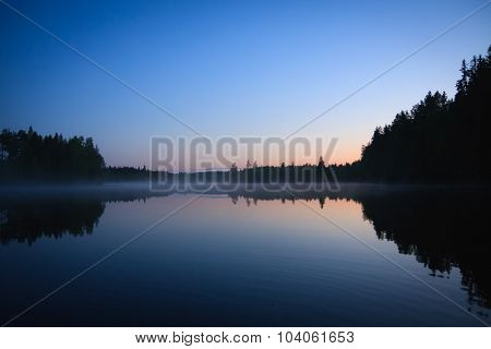 Calm lake scape at summer night