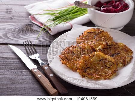 Potato fritters with beet salad and green onions