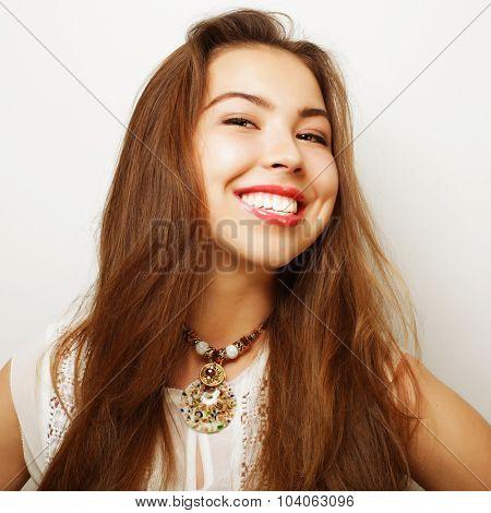Beautiful young happy woman. Studio shot.