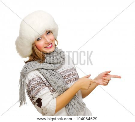 Young girl shows pointing gesture isolated