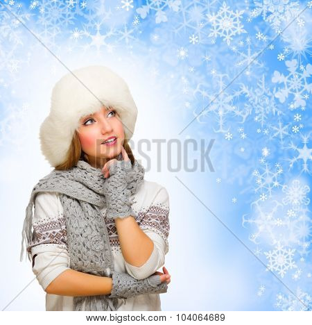 Young thinking girl on winter background