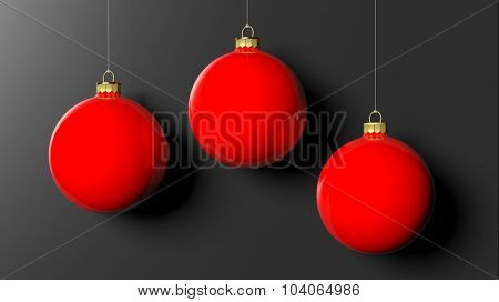 Red Christmas balls, isolated on black background.