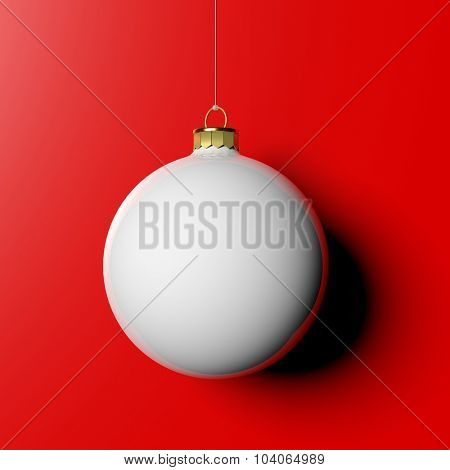White Christmas ball, isolated on red background.