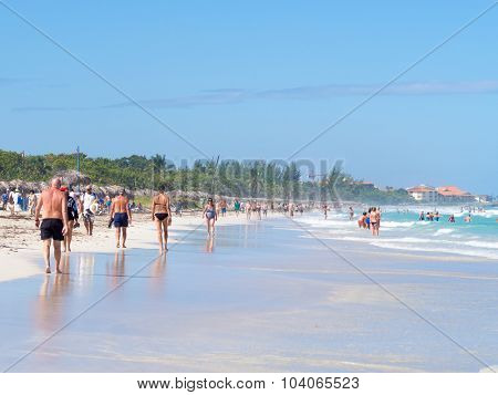 VARADERO,CUBA - OCTOBER 4, 2015 : Tourists at the beautiful beach of Varadero in Cuba