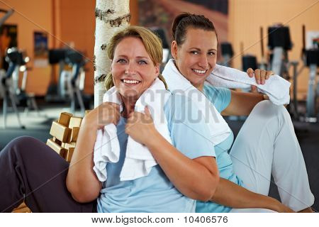 Women Relaxing After Fitness Training