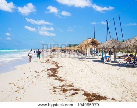 VARADERO,CUBA - OCTOBER 3, 2015 : Tourists relaxing and sunbathing at the beautiful beach of Varadero in Cuba